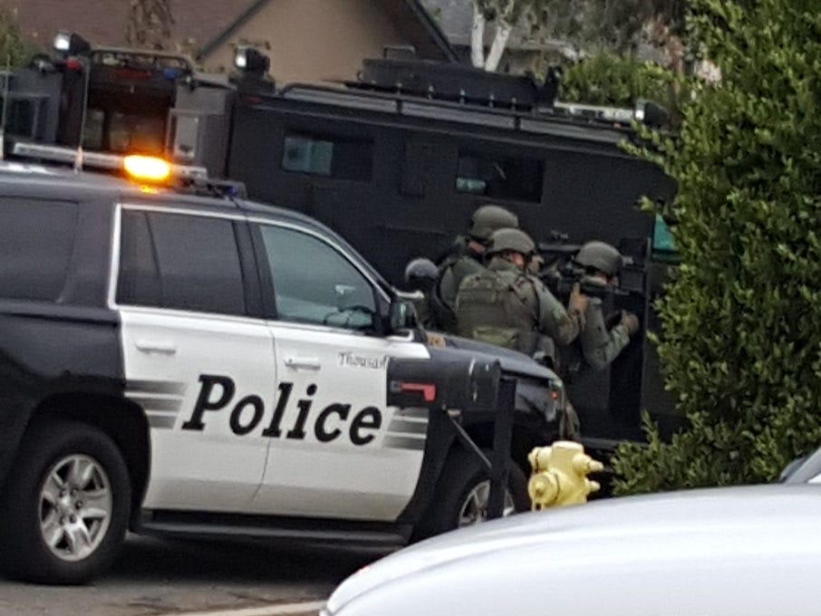 A Ventura County Sheriff's SWAT team responds Wednesday morning to a barricade on Teasdale Street in Thousand Oaks.