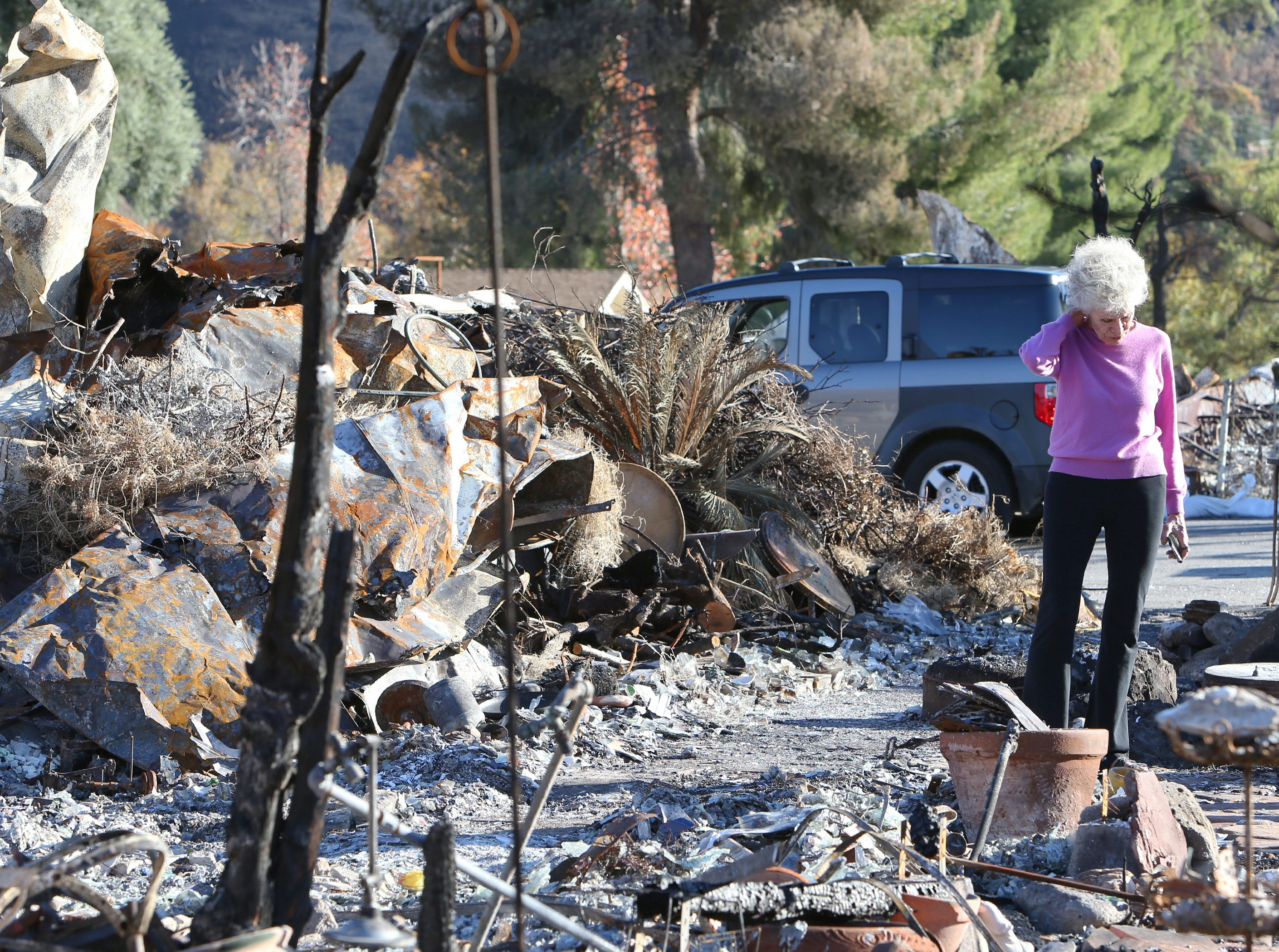 Marsha Maus stands amid the ruins of her mobile home, which was destroyed when the Woolsey Fire burned through the Seminole Springs Mobile Home Park in Agoura Hills. The fire destroyed 1,197 homes in Ventura and Los Angeles counties.