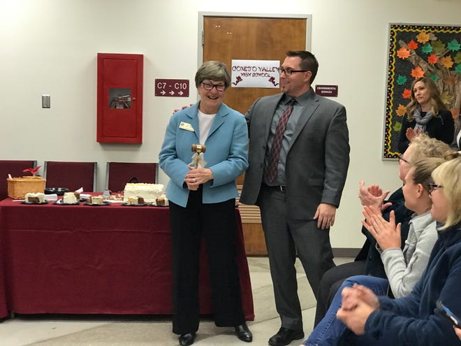 Pat Phelps and Superintendent Mark McLaughlin stand during a reception honoring outgoing trustees on the Conejo school board Tuesday.