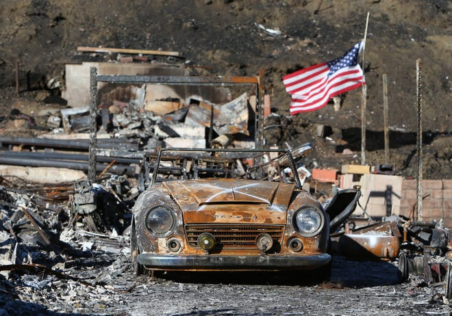 An American flag blows in the wind on a property in the Seminole Springs Mobile Park in Agoura Hills, where many homes were destroyed by the Woolsey Fire.