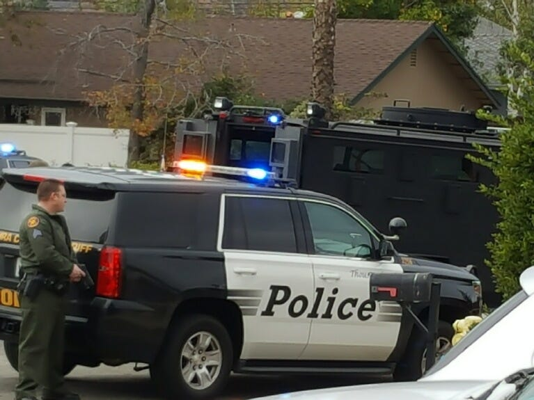 Ventura County Sheriff's deputies and SWAT team work outside a home on Teasdale Street in Thousand Oaks where a man has apparently barricaded himself Wednesday morning.
