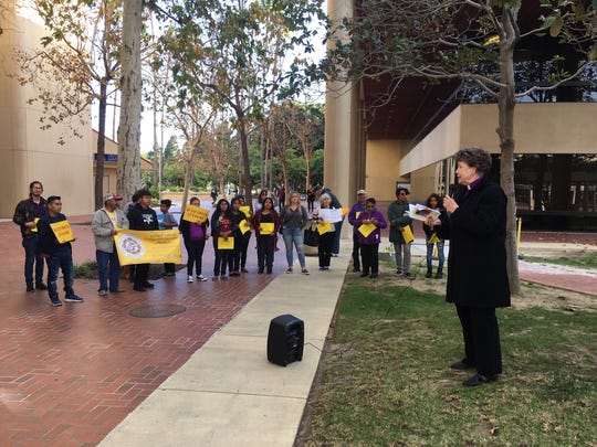 Members of Clergy and Laity United for Economic Justice - Ventura County (CLUE-VC) take part in a rally before a Truth Act hearing Tuesday. The hearing is required of any local law enforcement agency that provides information to federal immigration officials.