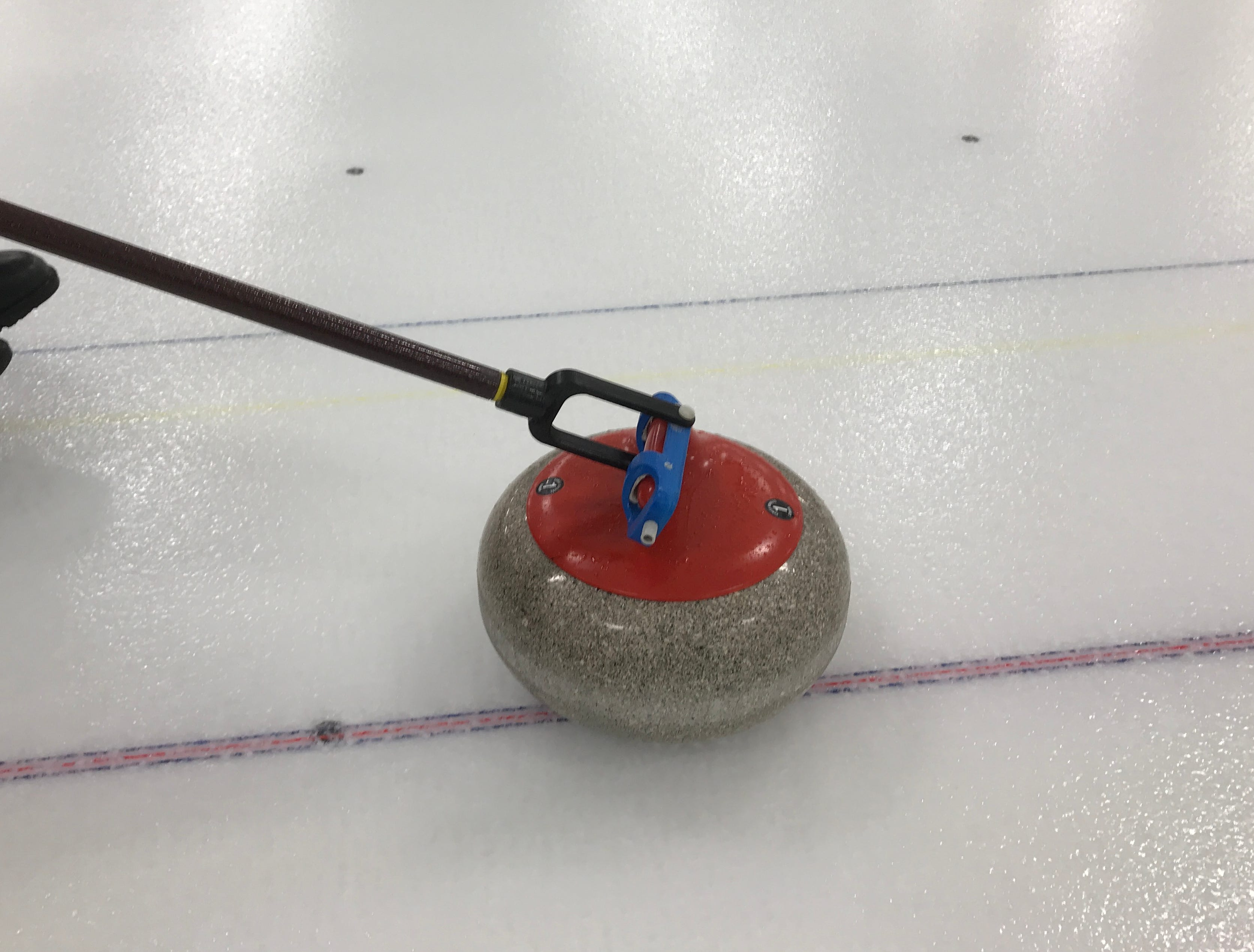 Thums uses a light pole to throw the rocks. He can spin the rock with the specially-designed fitting on the end. Wheelchair athletes don't sweep in their curling matches, as other athletes do. That means Thums' touch on the throws is especially important.