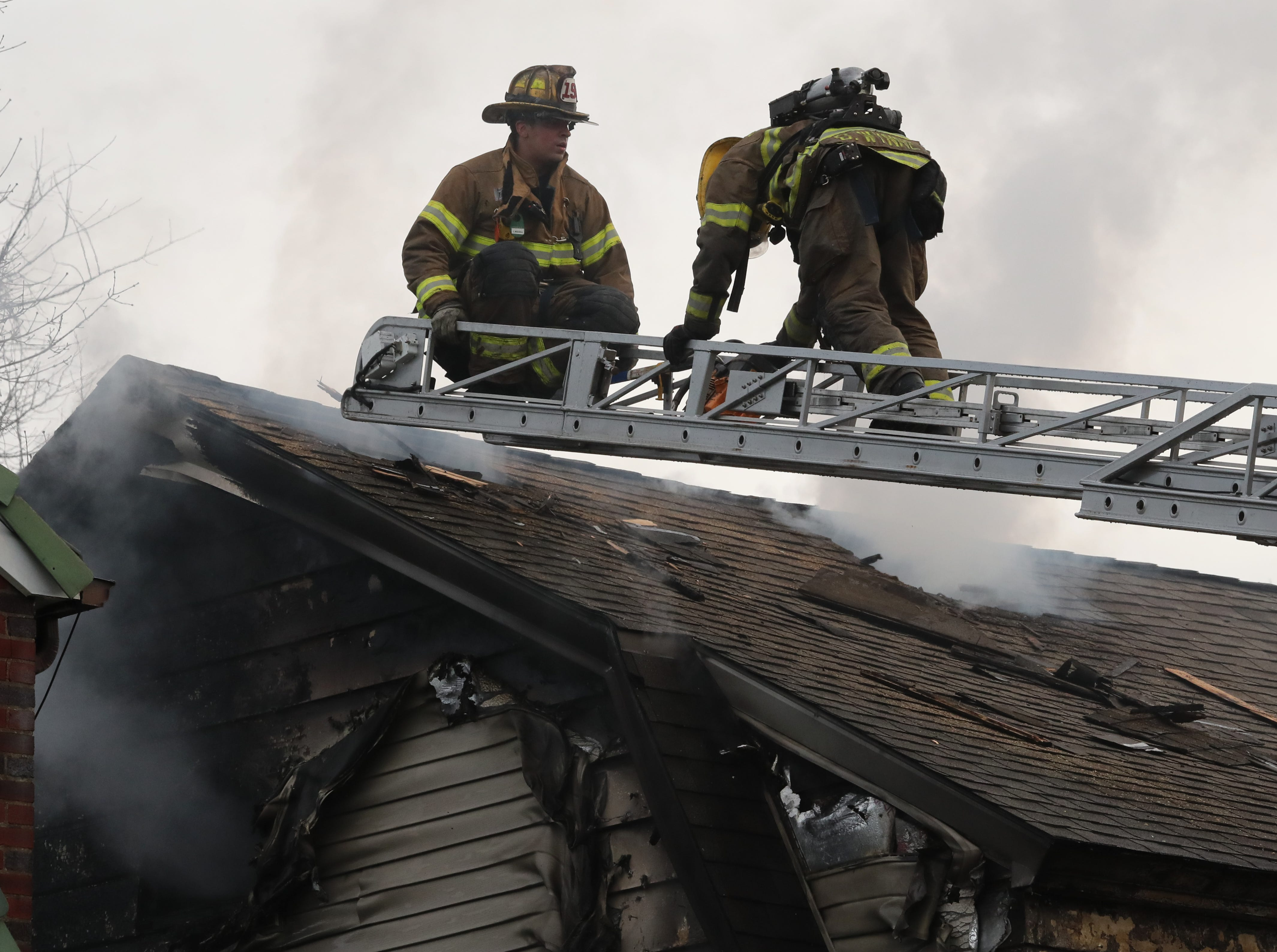 Suffern Fire Dept. firefighters vent the roof of a house fire on Washington Ave. in Suffern Dec. 5, 2018.