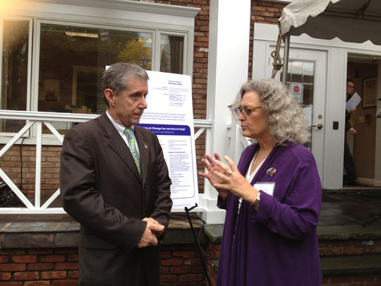Caroline Fish, executive director of the Center for Safety and Change, talks to Rockland District Attorney Thomas Zugibe before the start of a gathering Oct. 4, 2012, to mark Domestic Violence Awareness Month and recognize the organization's new name. For more than 30 years, the center was known as Rockland Family Shelter.