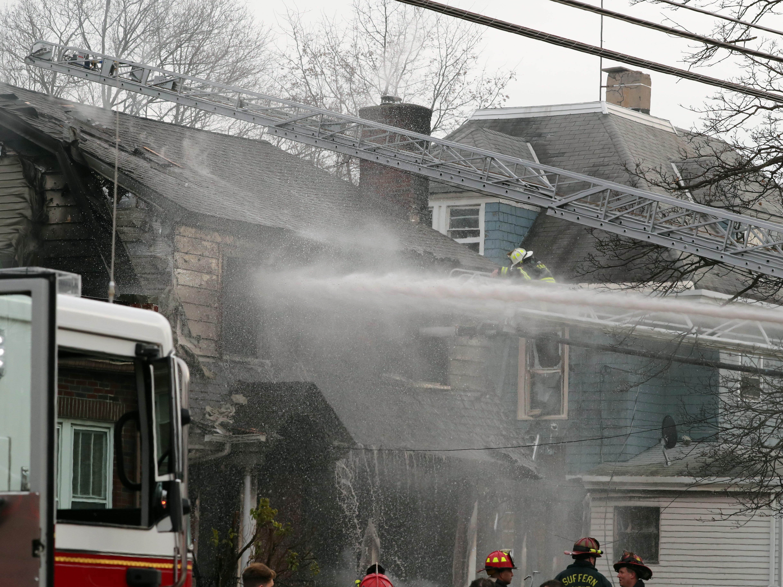 Firefighters battle a smokey house fire on Washington Ave. in Suffern Dec. 5, 2018.