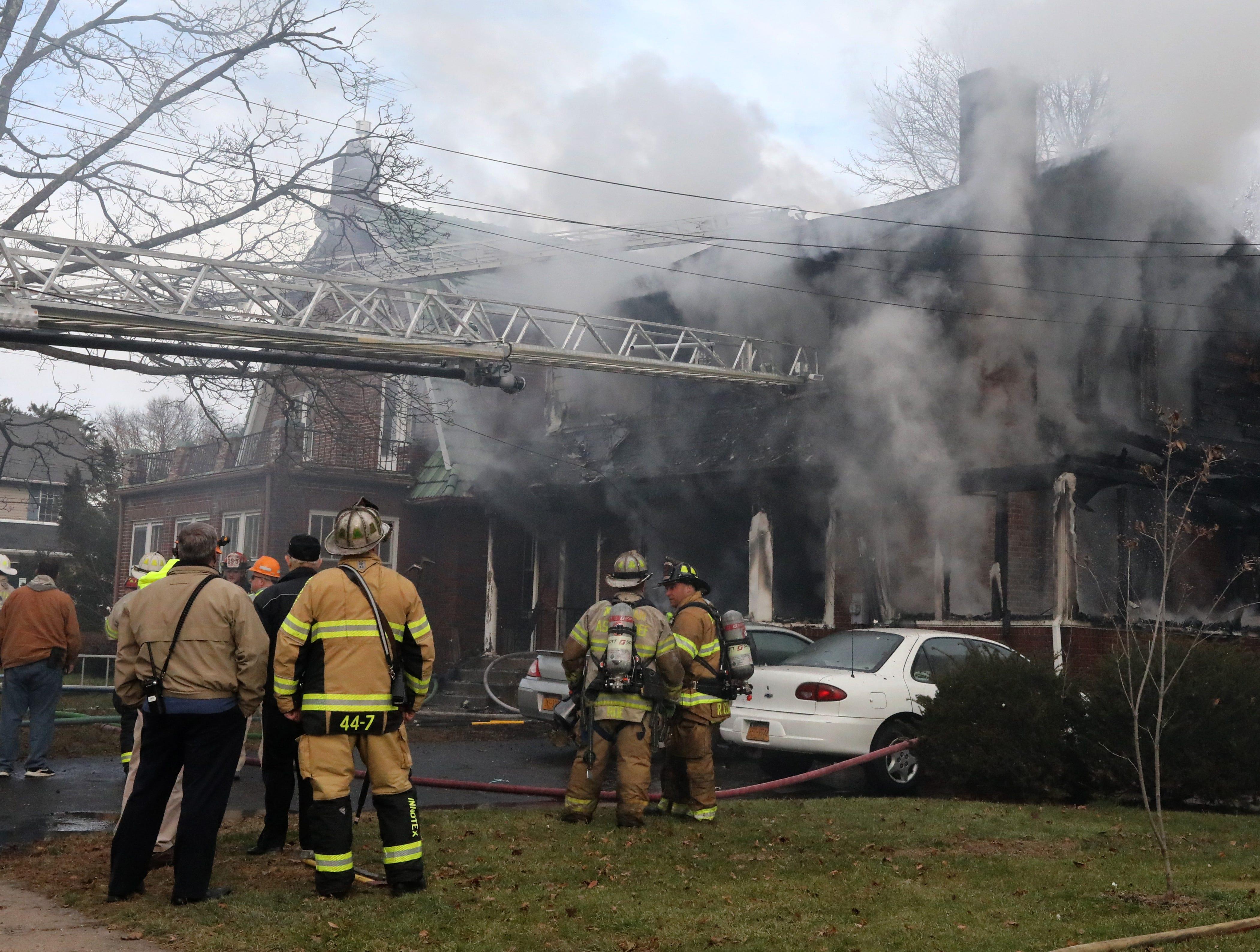 Firefighters battle a smokey fire on Washington Ave. in Suffern Dec. 5, 2018.