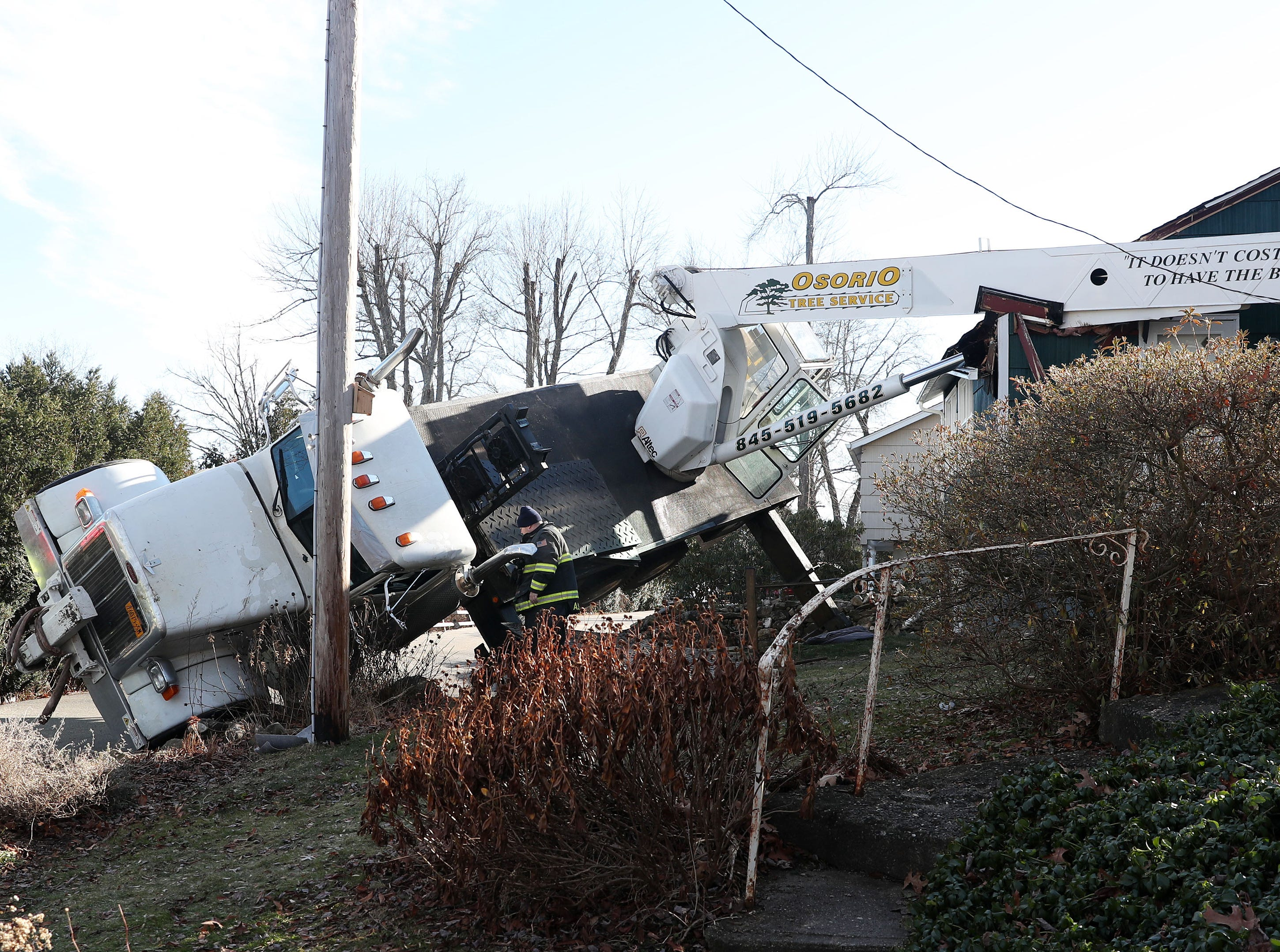 A boom truck crane tipped over while removing a large tree from behind a home at 45 Lakeside Drive in North Salem Dec. 5, 2018. There were no injuries.