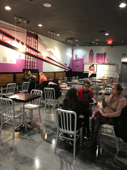 The interior of Bona Bona Ice Cream in Port Chester. Note the mural of the Bona Bona truck in the background. Photographed Dec. 4, 2018.