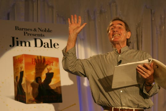 "Jim Dale gestures as he reads an excerpt from an earlier Harry Potter book during the festivities leading up to the sale of J. K. Rowling's ""Harry Potter and the Deathly Hallows"" at a Barnes and Noble in New York on July 20, 2007. The seventh and final book in the ""Potter"" series went on sale July 21, 2007 at 12:01 a.m., when the release of a new Rowling work was an event."