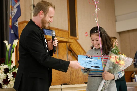 Lee Overtree, creative director of Story Pirates announced the winner of a national contest, a student at the Elmwood Elementary School, Angie Ortiz, 11, from Spring Valley at the school on Dec. 5, 2018.  Her story idea will be published in Random House in 2020.