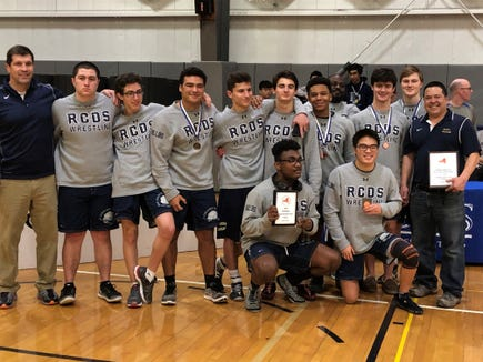 The Rye Country Day wrestling team at the 2018 NYSAIS championships.