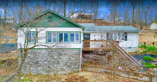 Putnam Valley home, built in 1929, has Oscawana Lake rights and views of the Appalachian Mountains.