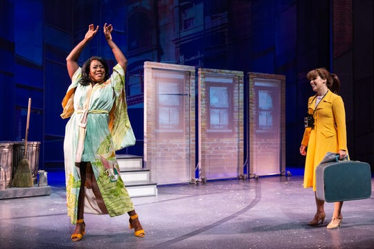 New roomie Tanya (Crystal Lucas Perry) welcomes Cindy (Chilina Kennedy) to New York in Delaware Theatre Co.'s 'A Sign of The Times.' The Three doors in the background are images projected on screens that constantly move and become part of many scenes.