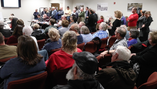 An overflow crowd fills the meeting room as the New Castle County Planning Board hears public comment on a plan to develop the former Three Little Bakers golf course in Pike Creek Tuesday.