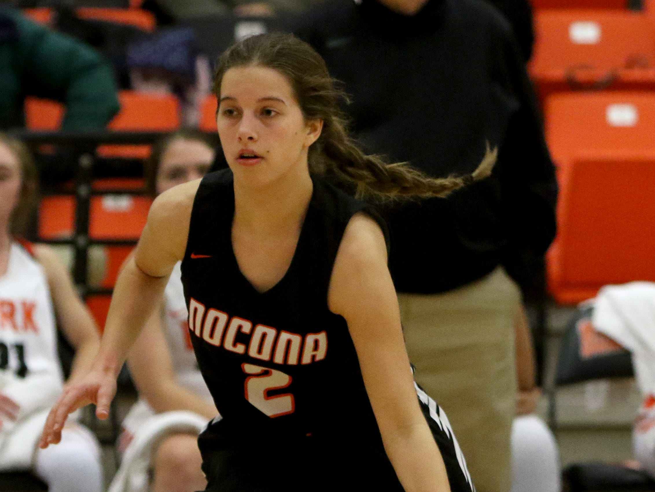 Nocona's Trystin Fenoglio drives to the basket in the game against Burkburnett Tuesday, Dec. 4, 2018, in Burkburnett.