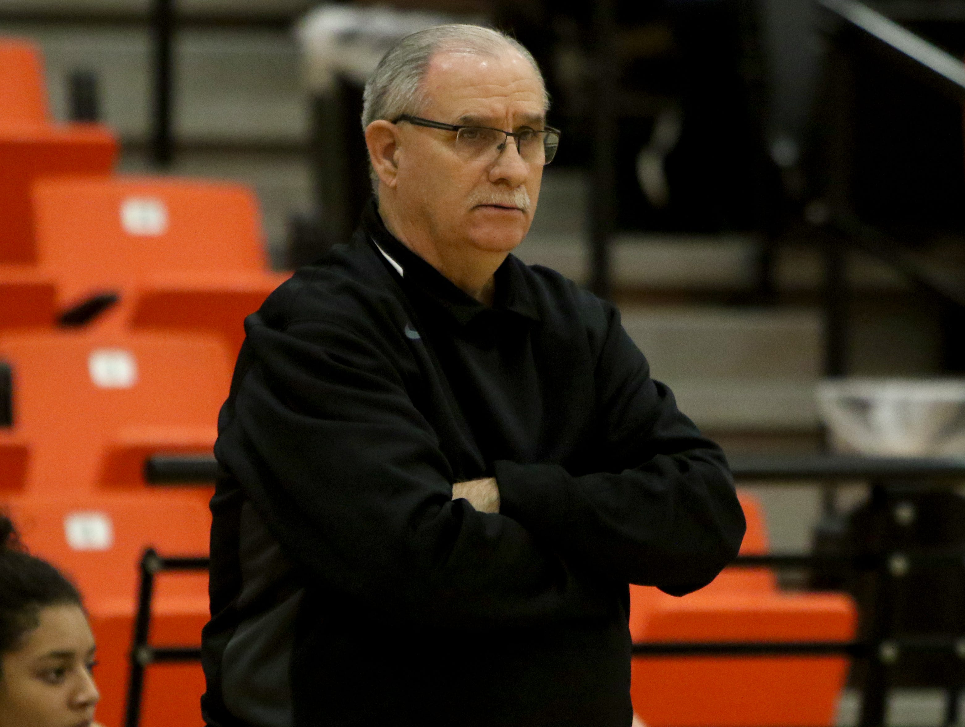 Burkburnett head basketball coach Alex Koulovatos watches his team in the game against Nocona Tuesday, Dec. 4, 2018, in Burkburnett.
