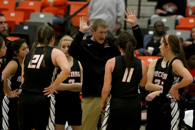 Nocona head basketball coach Kyle Spitzer talks to his players during a timeout in the game against Burkburnett Tuesday, Dec. 4, 2018, in Burkburnett.