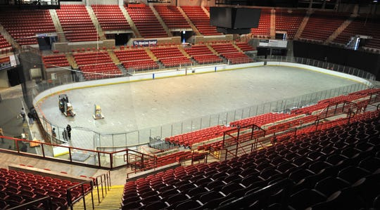 WFMPEC staff prepare to cover the iced arena at the Kay Yeager Coliseum for the soon-to-be-named Wichita Falls US Arena soccer team, Wednesday morning.