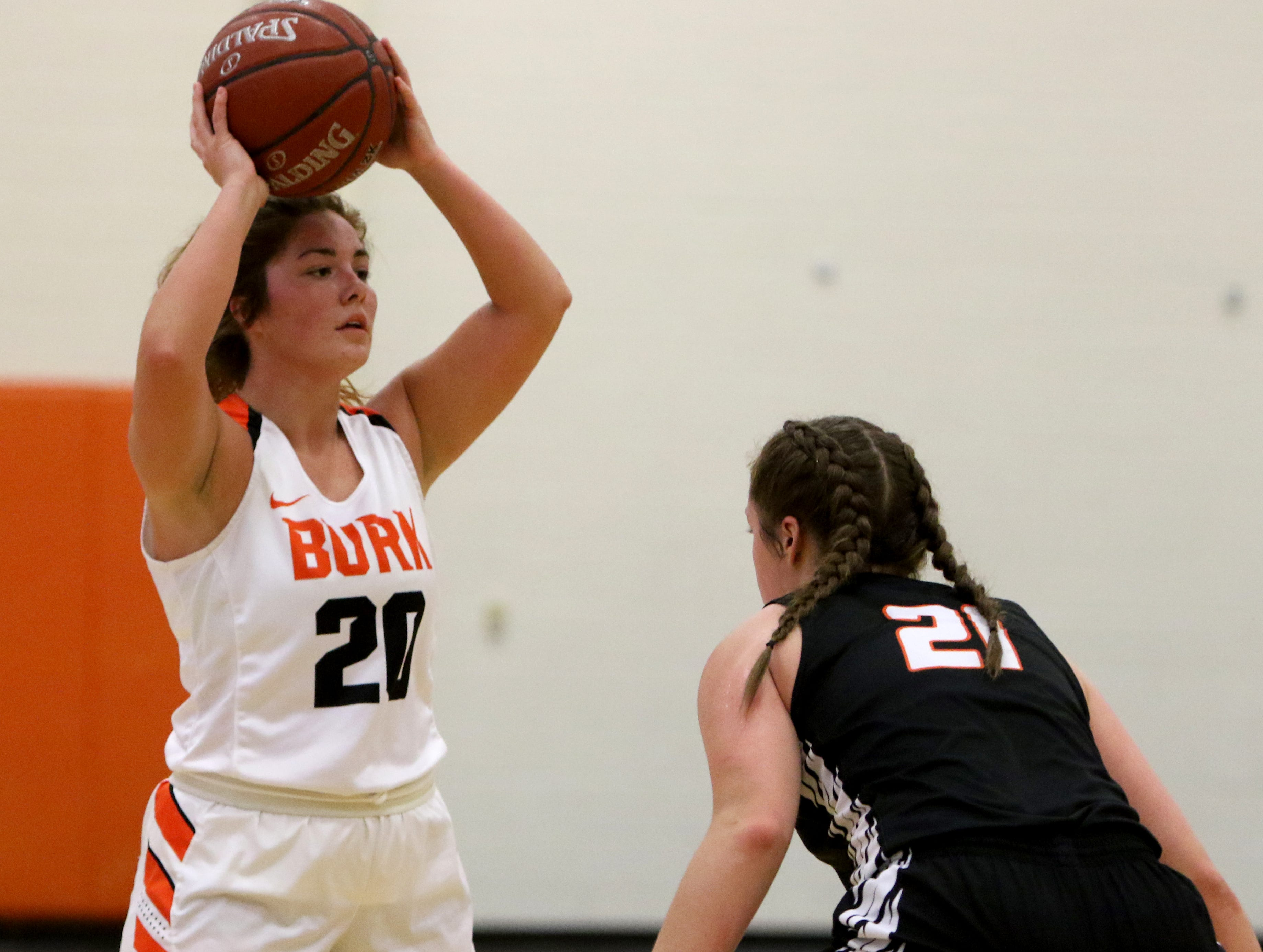 Burkburnett's Bailey Kosechata looks for an open teammate to pass to while guarded by Nocona's Averee Kleinhans Tuesday, Dec. 4, 2018, in Burkburnett.