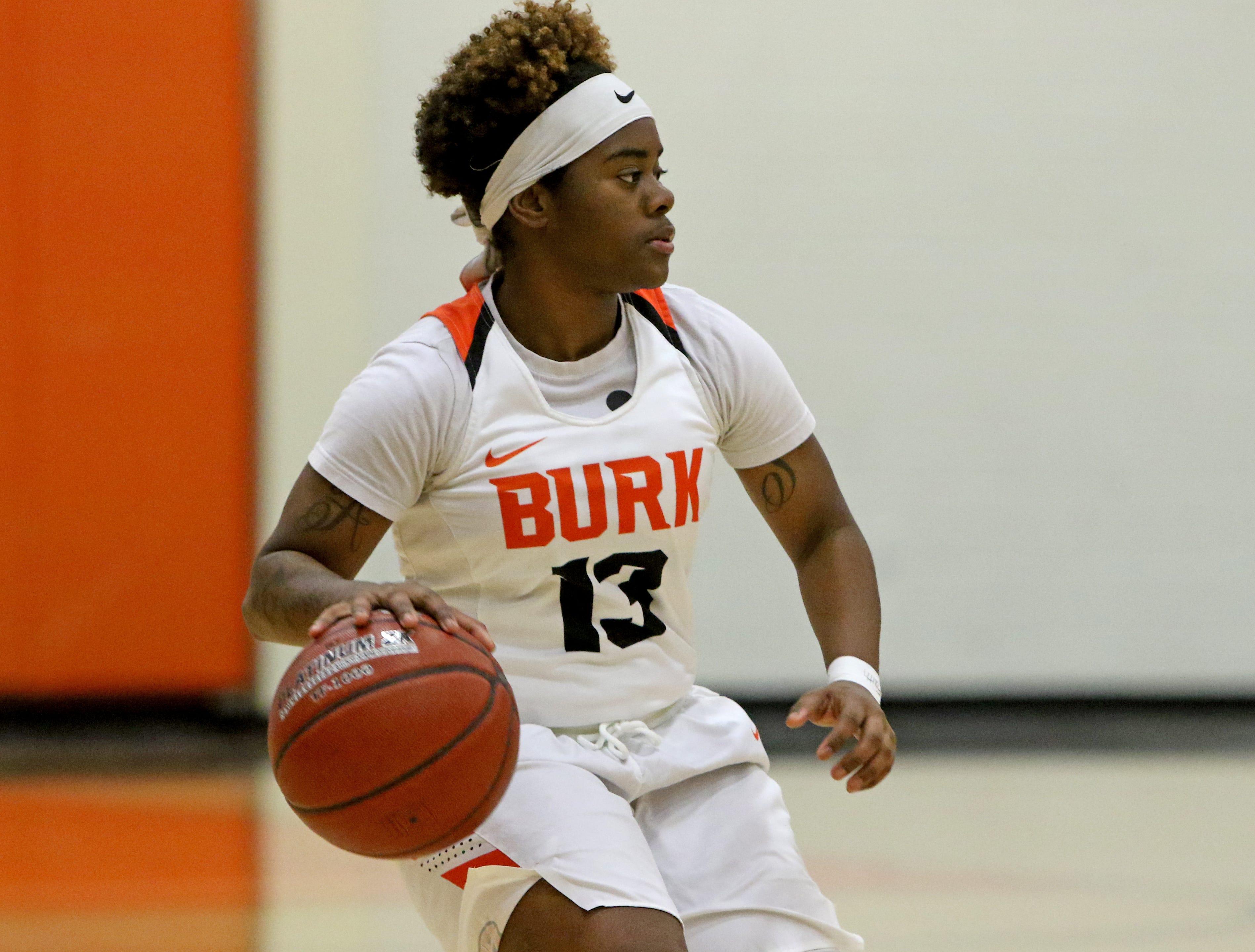 Burkburnett's Amiria Simoson dribbles in the game against Nocona Tuesday, Dec. 4, 2018, in Burkburnett.