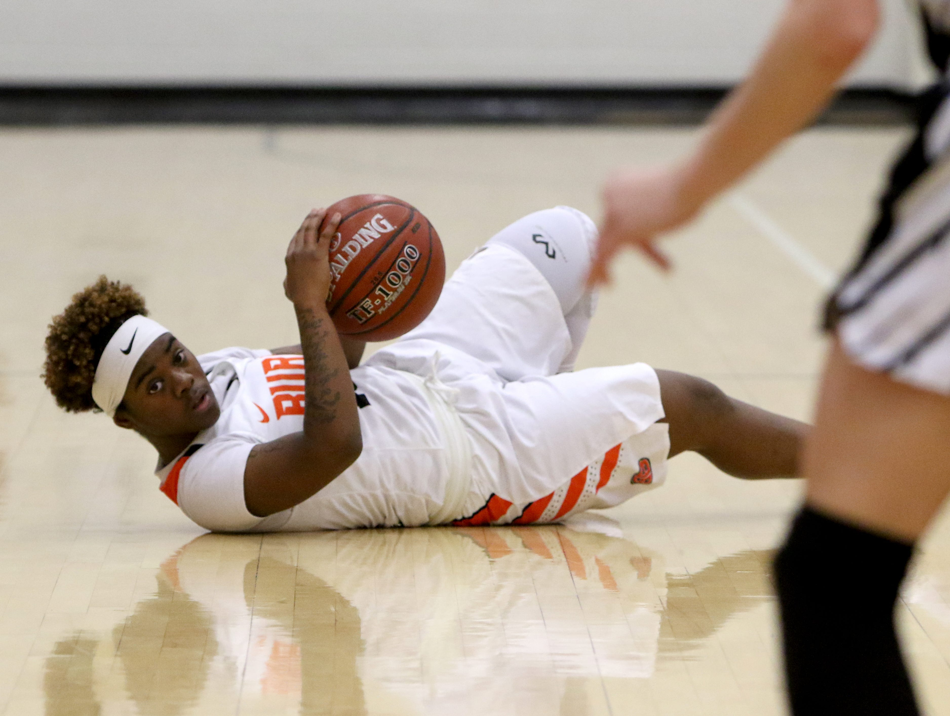 Burkburnett's Amiria Simpson looks for an open teammate after getting the loose ball in the game against Nocona Tuesday, Dec. 4, 2018, in Burkburnett.