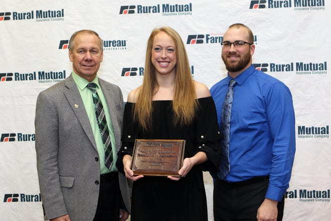 Justin and Livia Doyle of Mineral Point were selected for Wisconsin Farm Bureau Federation's Young Farmer and Agriculturist 2018 Excellence in Agriculture Award at the organization's 99th Annual Meeting in Wisconsin Dells, Dec. 2. They are pictured with WFBF President Jim Holte (left).