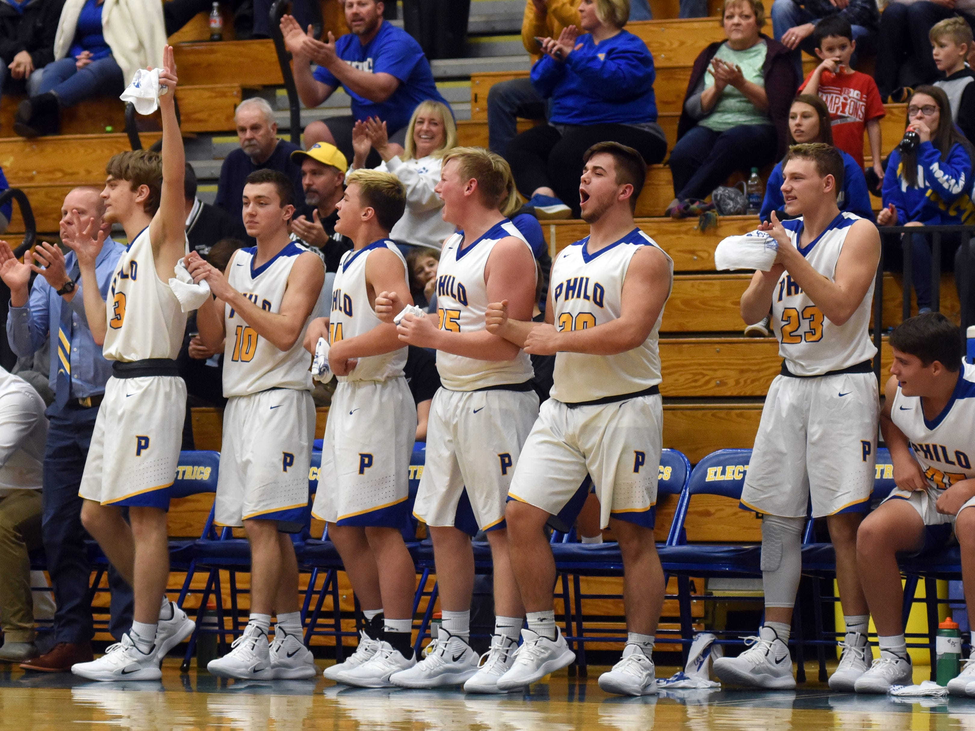 Philo's bench celebrates a basket against Sheridan.