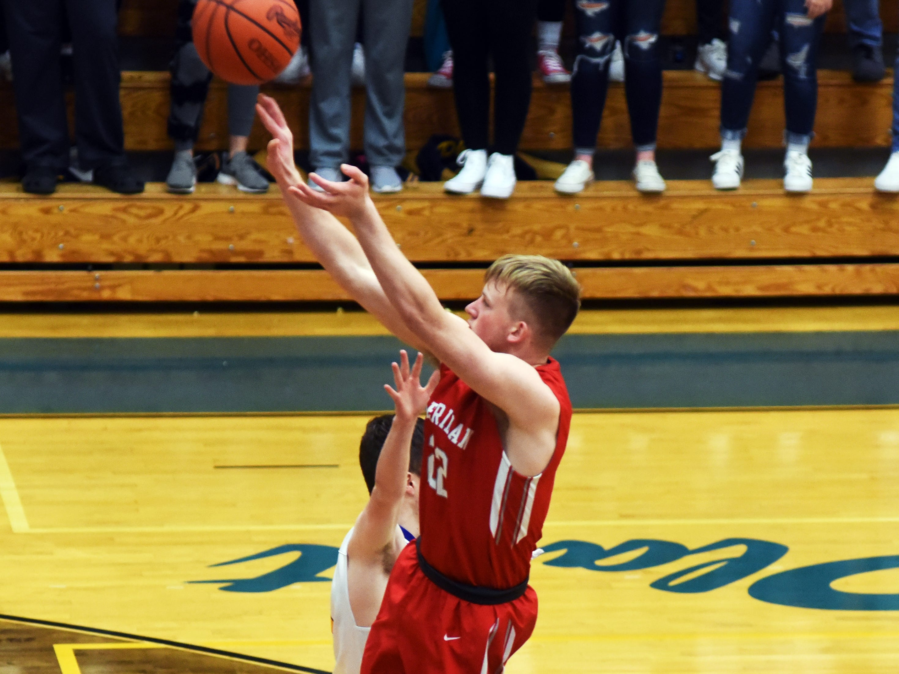 Sheridan's Landen Russell shoots a jumper against Philo.