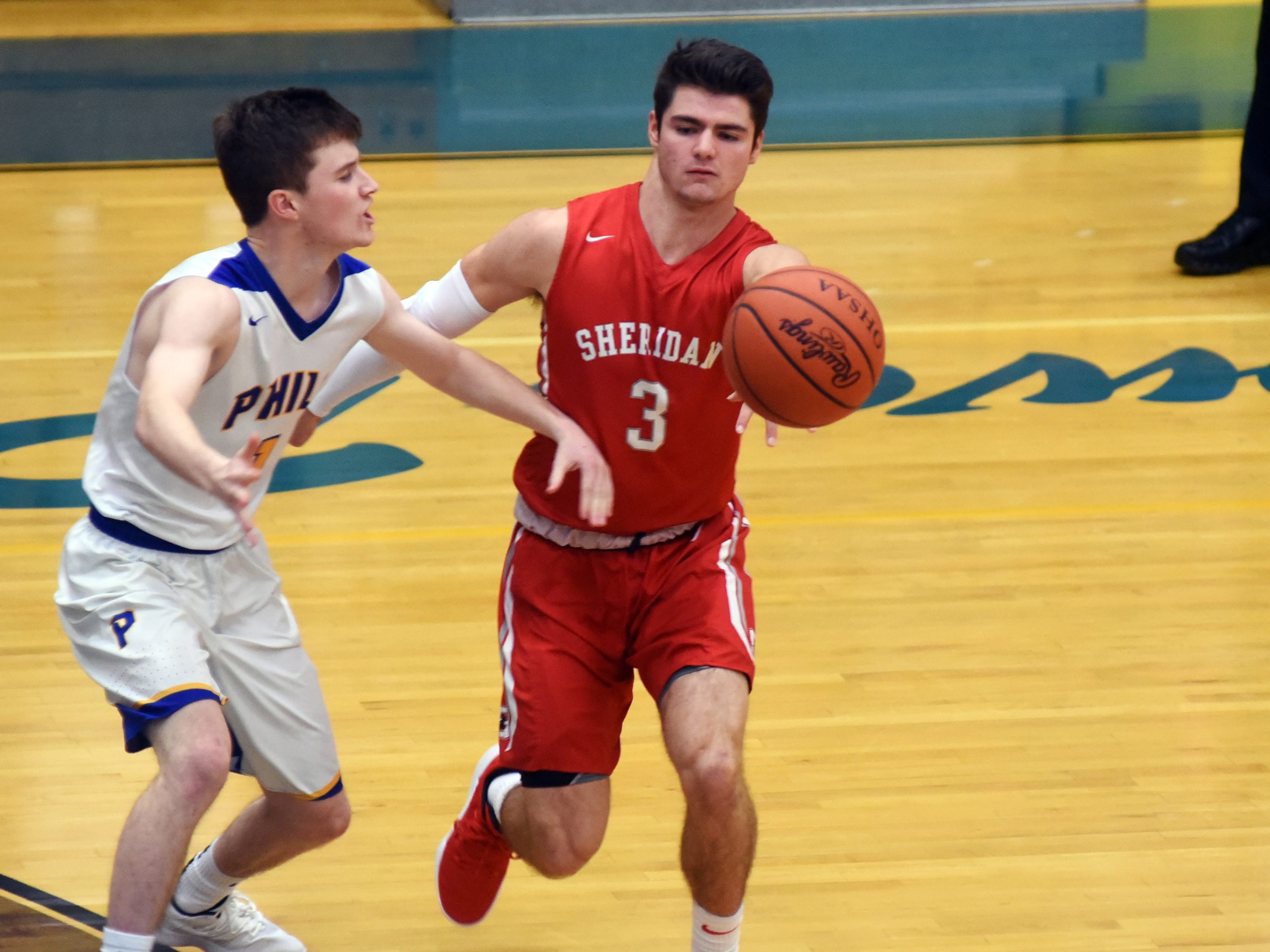 Sheridan's Ethan Heller passes to a teammate against Philo.
