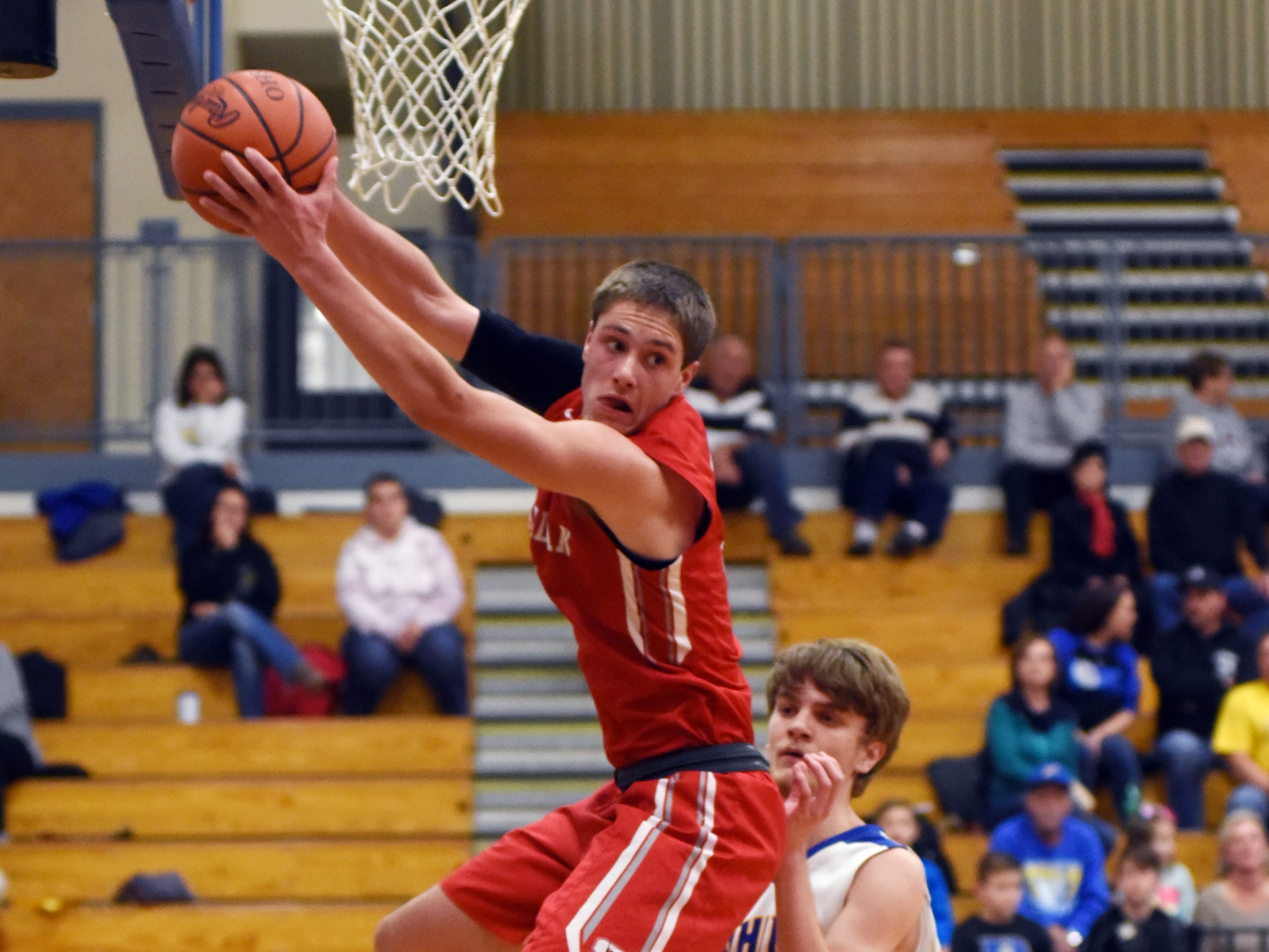 Sheridan's Luken Hill pulls down a rebound against Philo.