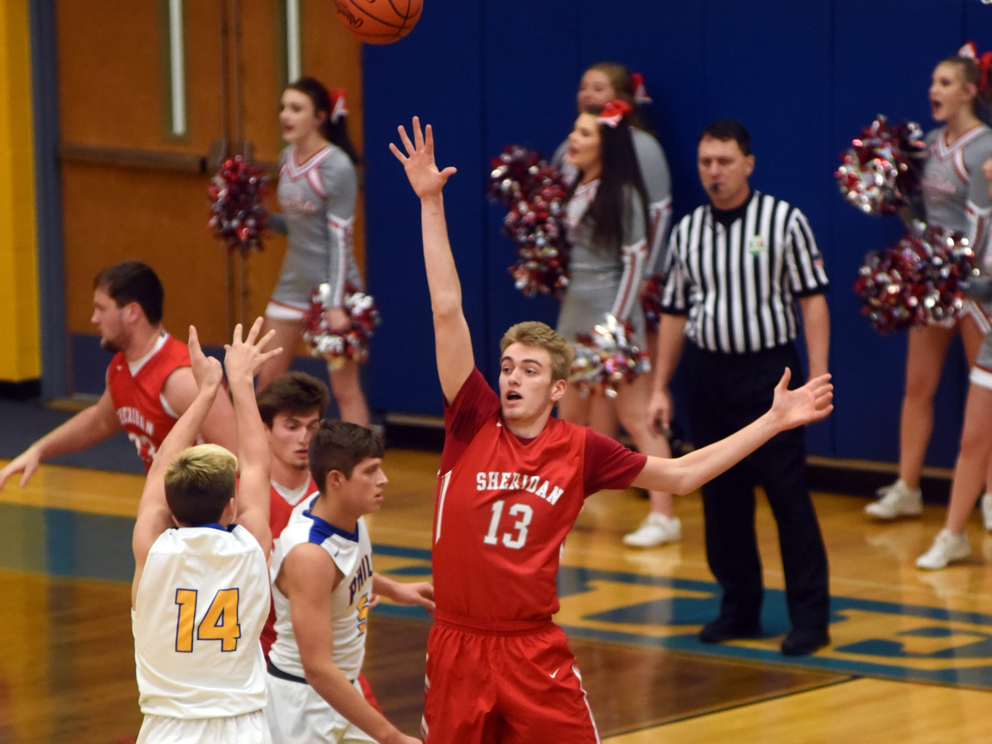 Philo's Owen Smith shoots over Sheridan's Michael Jordan.
