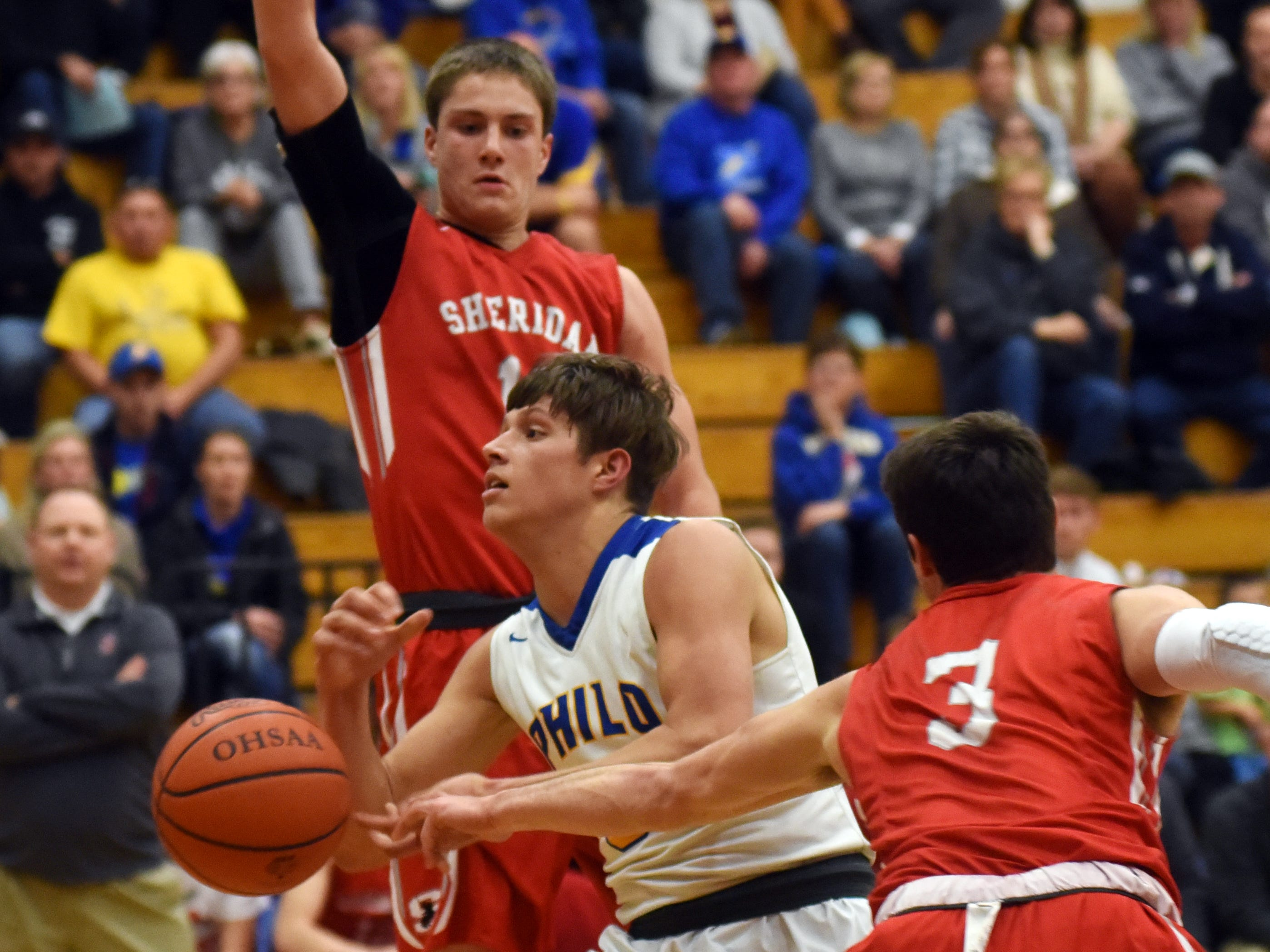 Cody Butler, of Philo, drives through traffic against Sheridan.