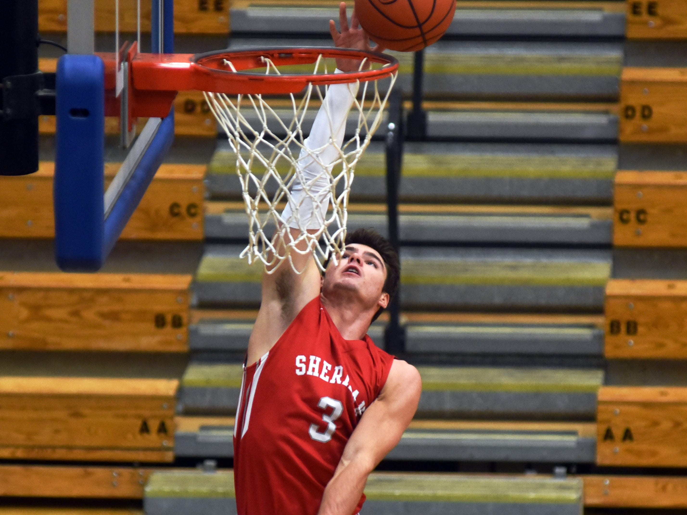 Sheridan's Ethan Heller goes up for a layup against Philo.