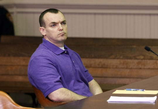 John Iden listens during his trial in Muskingum County Common Pleas Court on Wednesday.