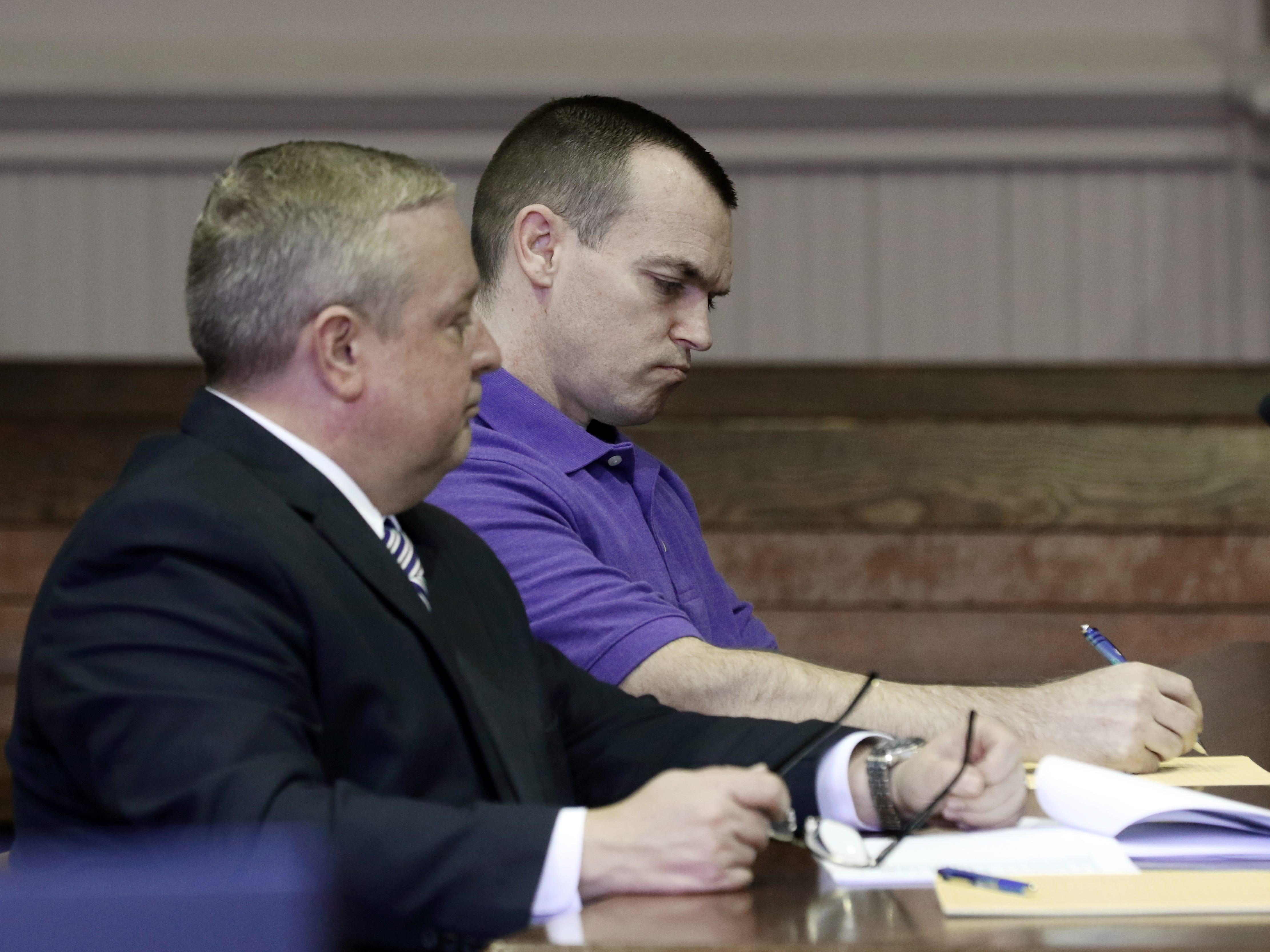 John Iden. takes notes during Muskingum County Assistant Prosecutor Ron Welch's opening statement in the Iden's trial.