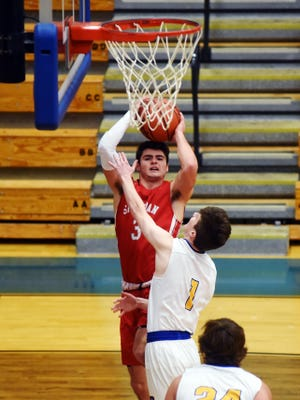 Ethan Heller goes up for a shot over Philo's Trey Lutz during the first quarter of Sheridan's 64-61 win on Tuesday night at The Power Plant. Heller scored a game-high 25 points as the Generals staved off a fervent Electric comeback attempt in the fourth quarter.