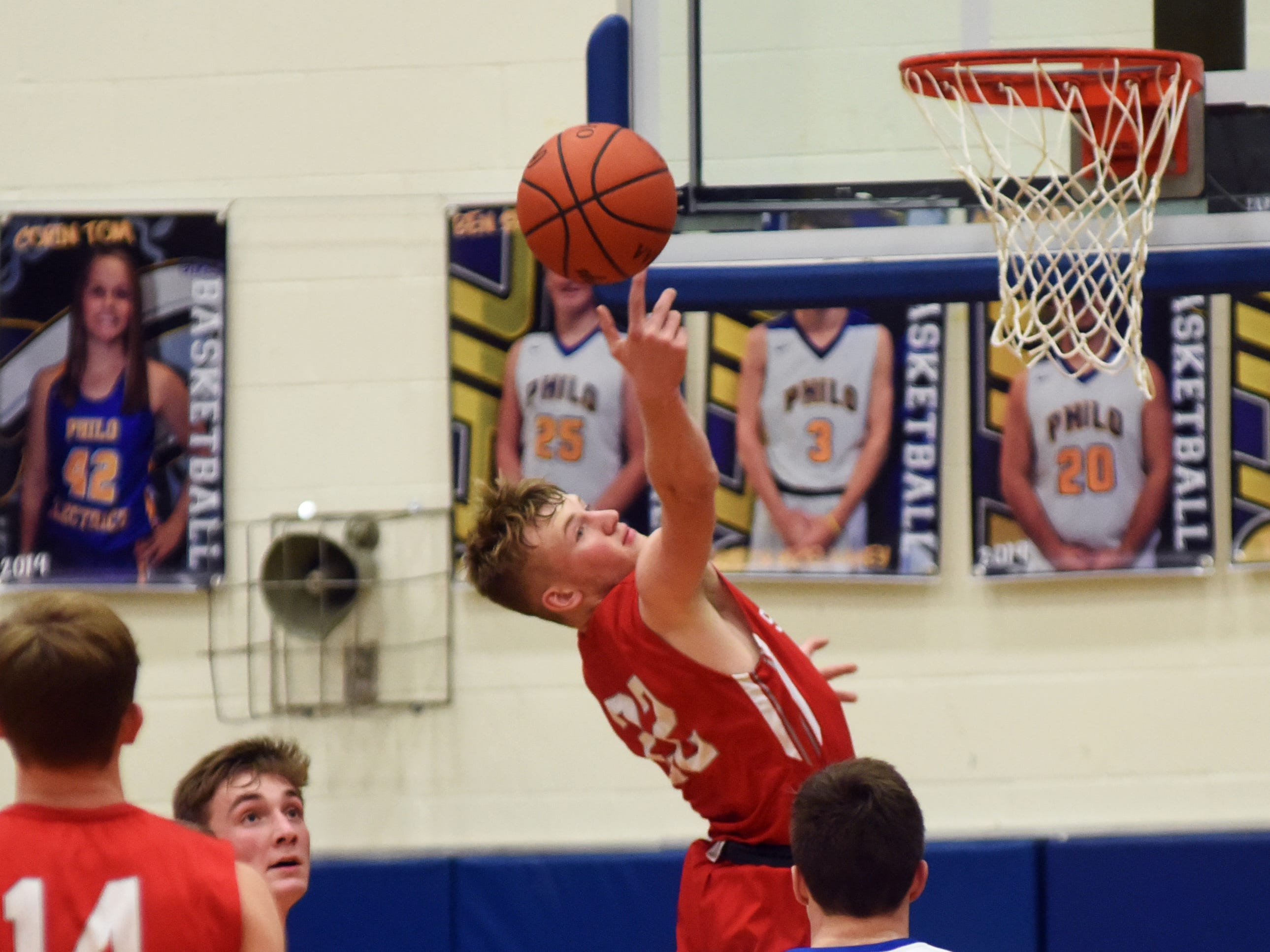Sheridan's Landen Russell goes up for a rebound against Philo.