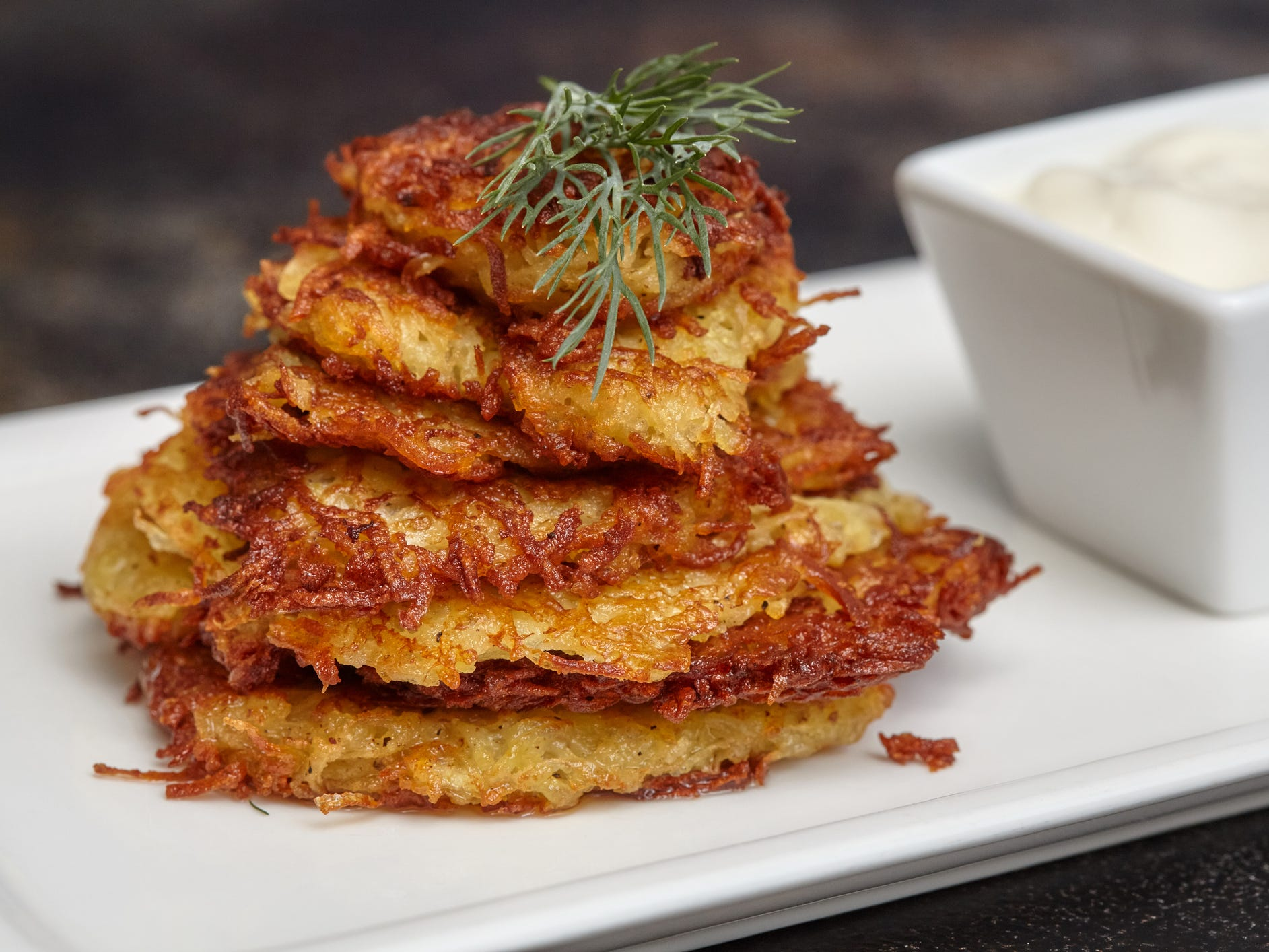 Latkes, Israel: Traditionally made for Hanukkah, latkes are potato pancakes that are fried in plenty of oil, then served with toppings such as sour cream or apple sauce. Much like potato chips, it's pretty much impossible to eat just one latke, which is unfortunate since each tiny treat has about 5 grams of fat.