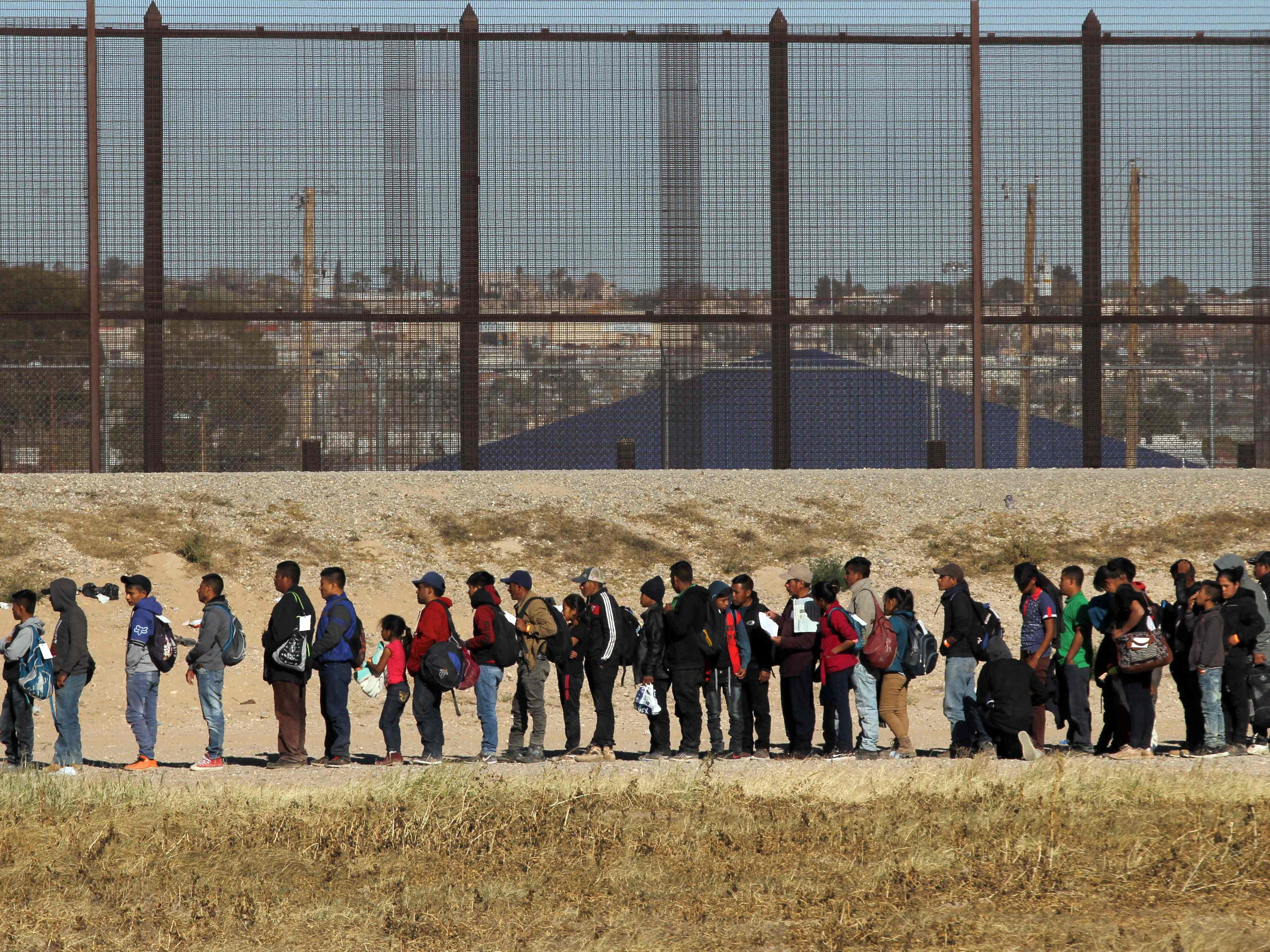 Nearly 150 Central American migrants seeking political asylum in the United States are detained by the Border Patrol, after entering the US through the Rio Grande, along the border with Ciudad Juarez, Chihuahua state, Mexico, on Dec. 3, 2018.