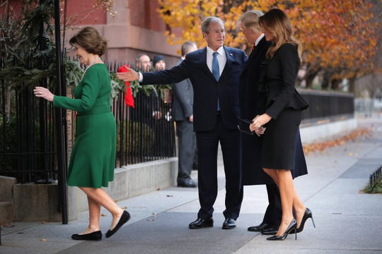Former first lady Laura Bush and former President George W. Bush greet President Donald Trump and first lady Melania Trump paying a condolence visit to Blair House, Dec. 4, 2018.