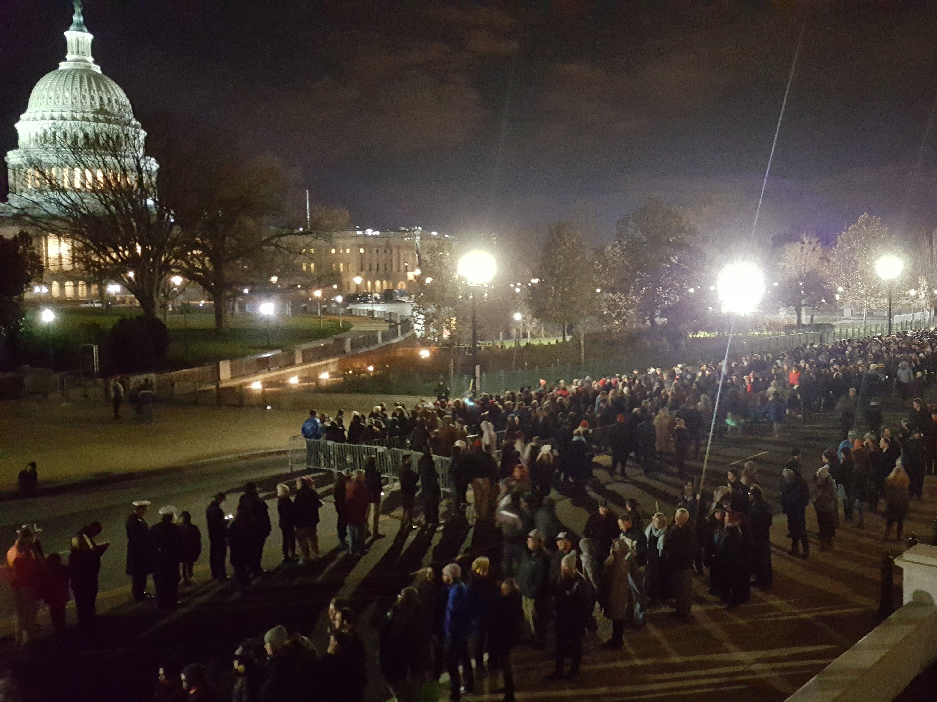 A line of people wait in line to pay their respects to former President George H.W. Bush at the Capitol in Washington, Dec. 4, 2018.