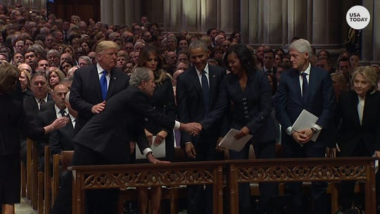 George W. Bush, Michelle Obama continue inside joke at funeral