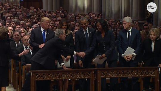 George W. Bush, Michelle Obama continue inside joke at funeral