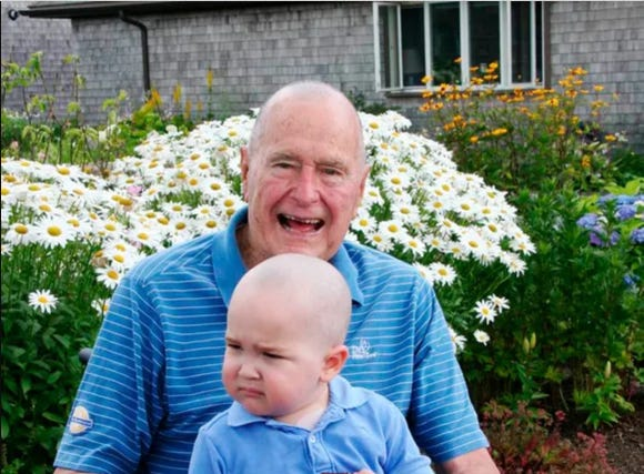 Former President George H. W. Bush poses with Patrick, 2, in Kennebunkport, Maine.
