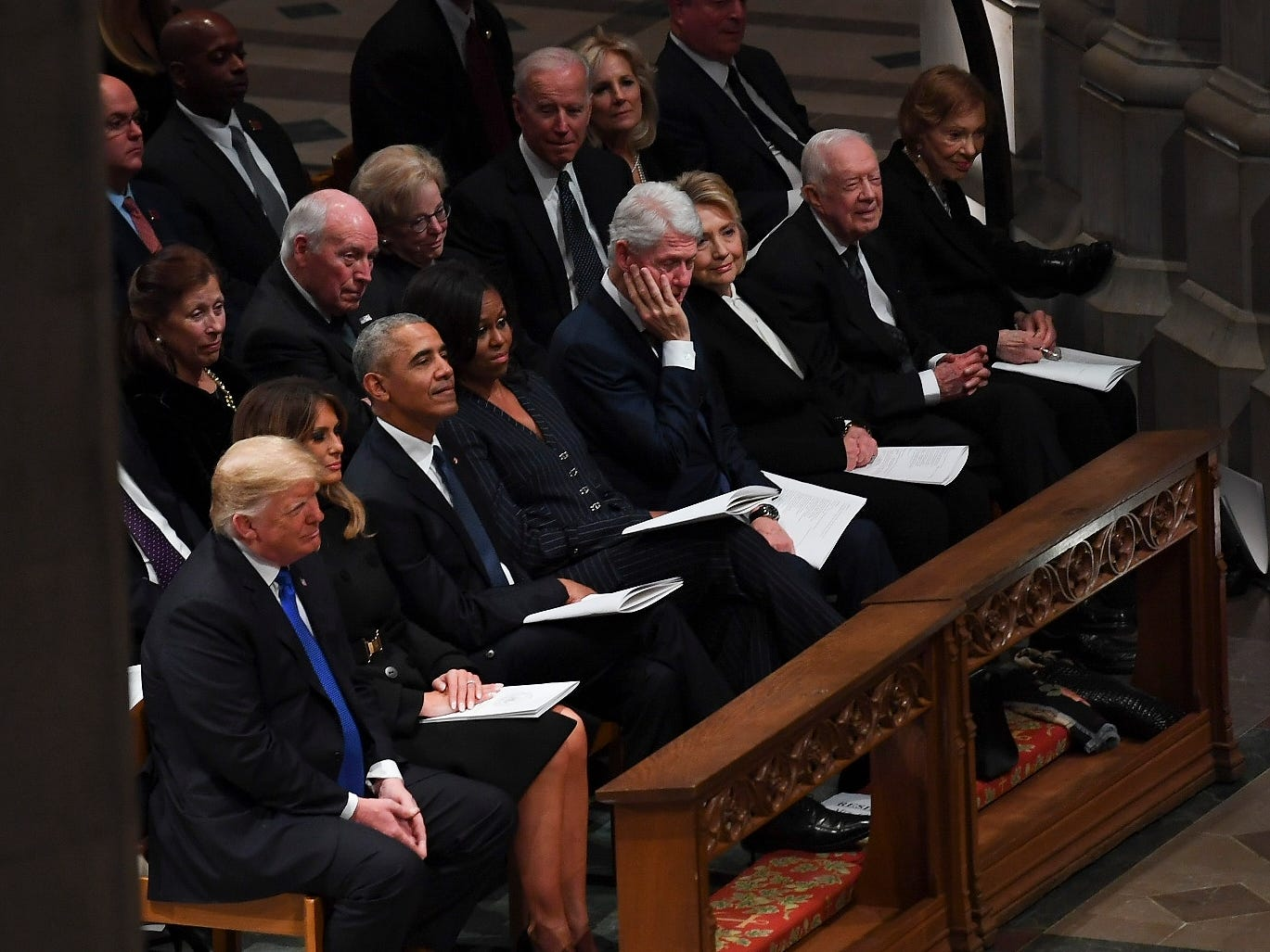 President Donald Trump, first lady Melania Trump, former President Barack Obama, Michelle Obama, former President Bill Clinton, former Secretary of State Hillary Clinton, former President Jimmy Carter and Rosalynn Carter, listen during a State Funeral for former President George H.W. Bush at the Washington National Cathedral, Dec. 5, 2018, in Washington.