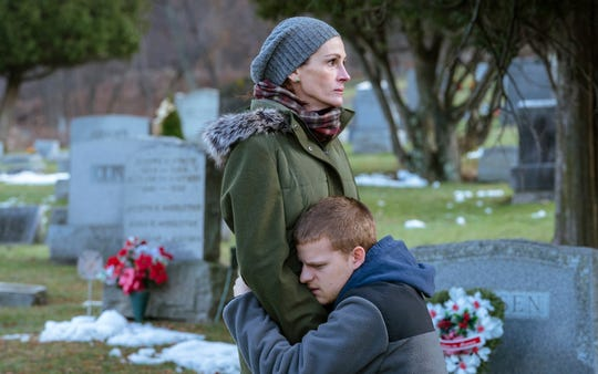 "Lucas Hedges, right, and Julia Roberts in a scene from ""Ben is Back."" (Mark Schafer/Roadside Attractions via AP) ORG XMIT: NYET819"