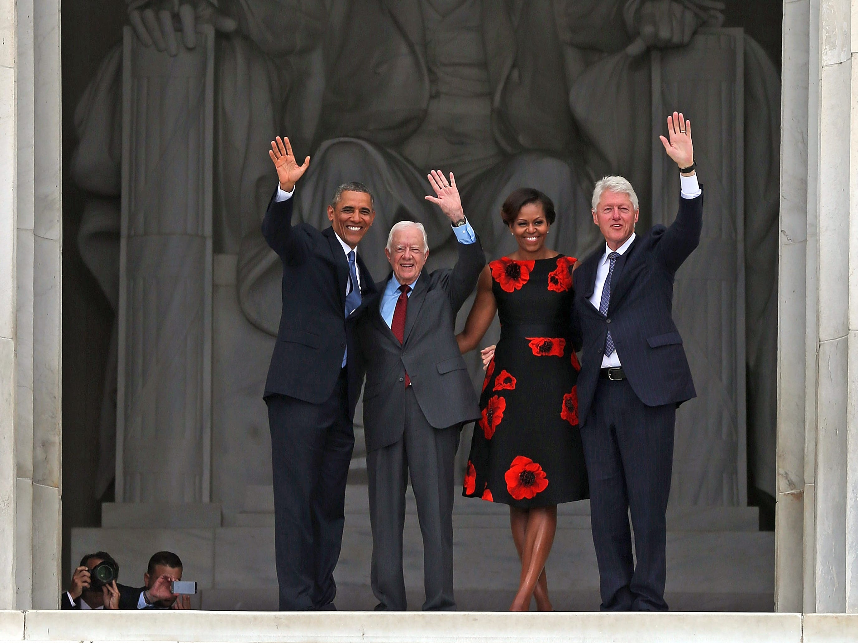 President Barack Obama, left, stands with his wife Michelle Obama, second from right, and former presidents Jimmy Carter, second from left, and Bill Clinton, right,  during the ceremony to commemorate the 50th anniversary of the March on Washington for Jobs and Freedom August 28, 2013 in Washington.