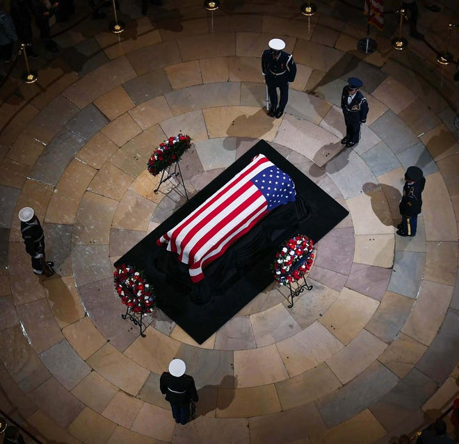 President George H.W. Bush is the 12th former president to lie in state at the U.S. Capitol Rotunda, as members of the military keep watch on Dec. 3.