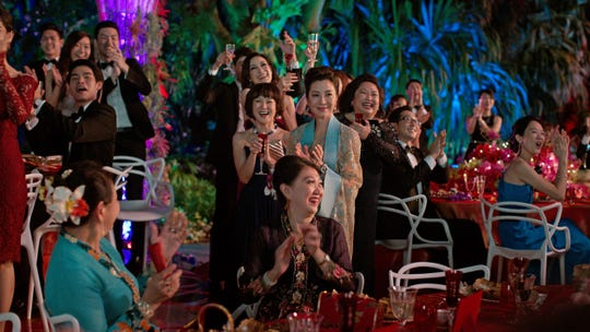 "MICHELLE YEOH (center) as Eleanor Young in Warner Bros. Pictures' and SK Global Entertainment's contemporary romantic comedy ""CRAZY RICH ASIANS,"" a Warner Bros. Pictures release."